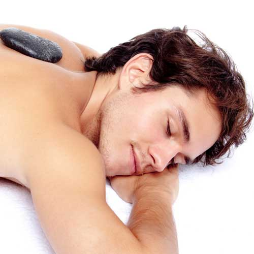 Man getting a hot stone massage